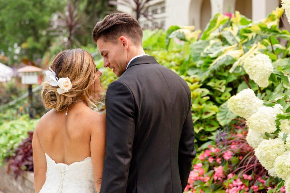 Bride and groom walking the pathway in front of Heritage Wedding Venue Elsie Perrin Williams Estate