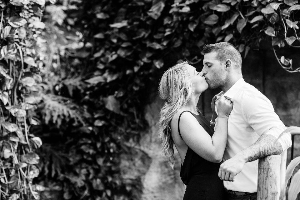 Engaged couple kissing