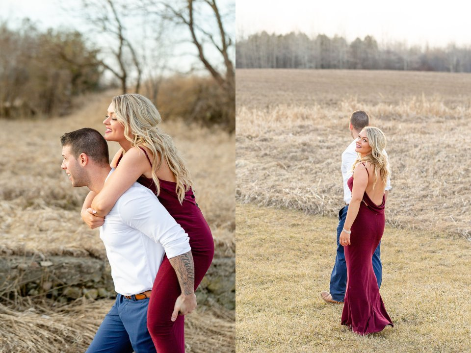 Man giving a woman a piggy back ride in a field