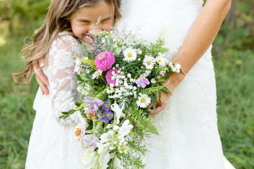 Bride holding a waterfall Bouquet by The Wandering Ivy