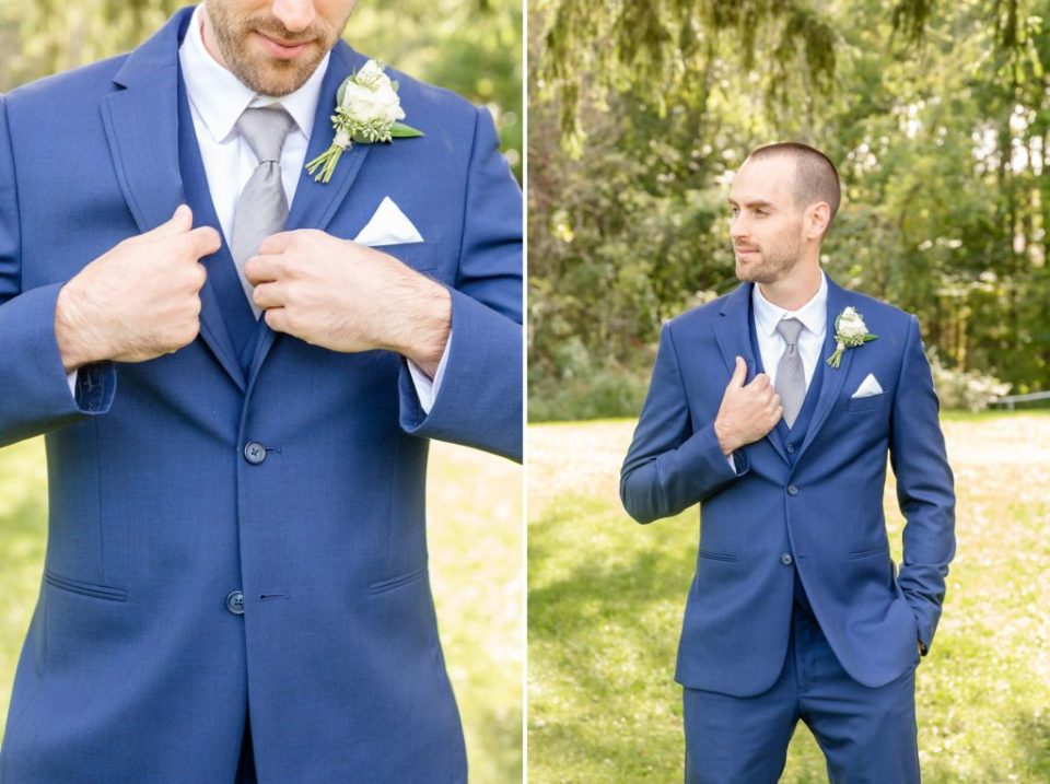 Portraits of the groom in his Moores Clothing suit on his wedding day at Windermere Manor