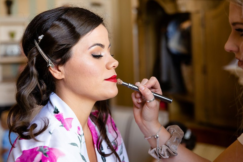 Finishing touches of makeup on her wedding day at The Retro Suites Hotel