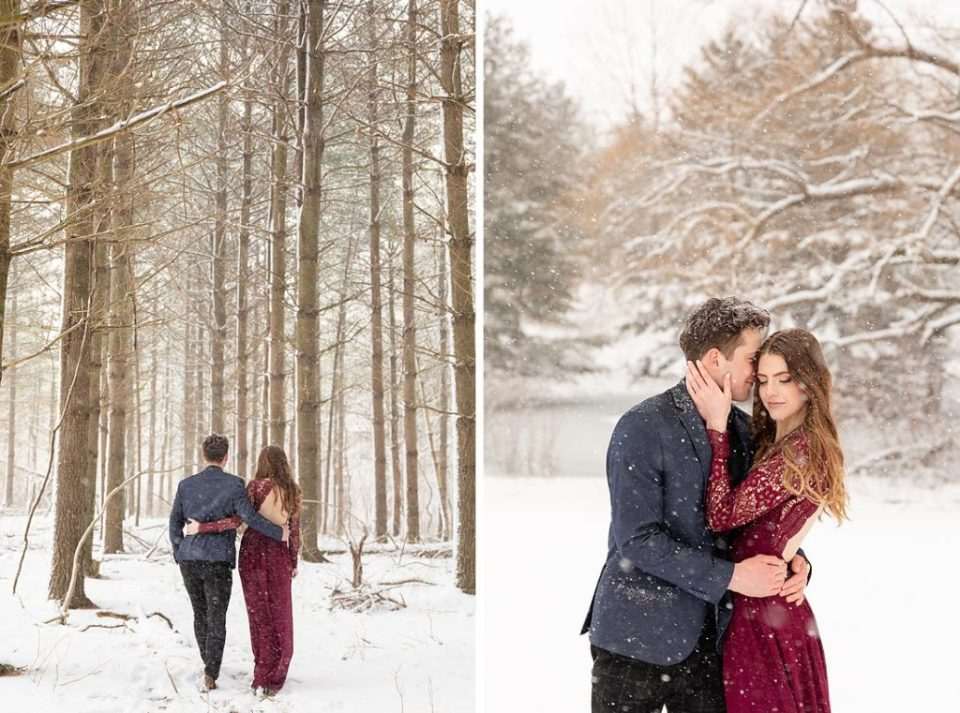 couple walking into pine tree forest and embracing
