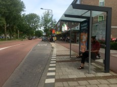 Bus stop with the cycle track behind it