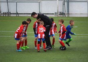 Grow your team. Grow your results. Boys soccer team with adult coach. photo by adria-crehuet-cano-664505-unsplash