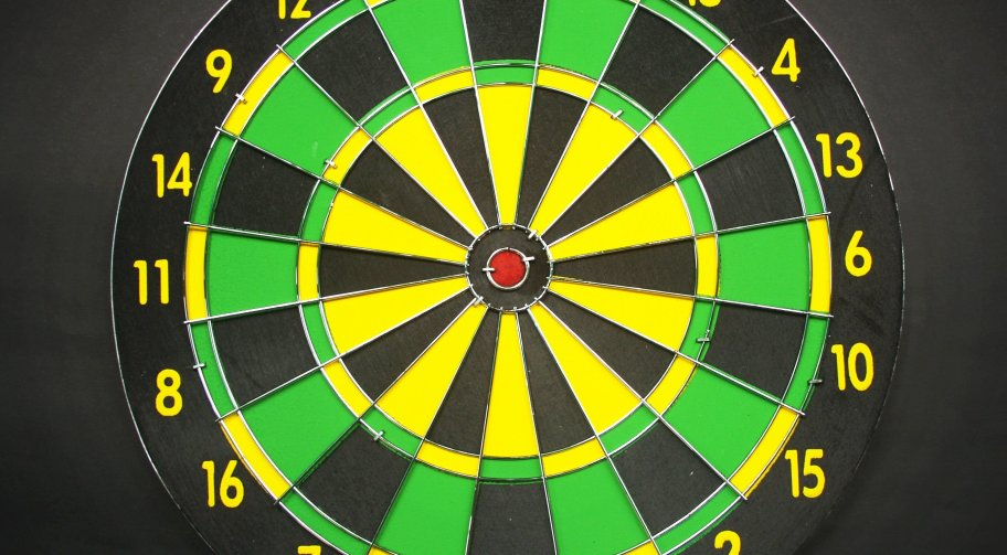 Green Yellow and Black Dart Board with Black Background. Photo by icon0.com via pexels.com.