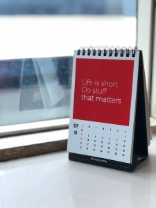 Spiral freestanding calendar on white surface: Photo by Manasvita S on Unsplash. Link.