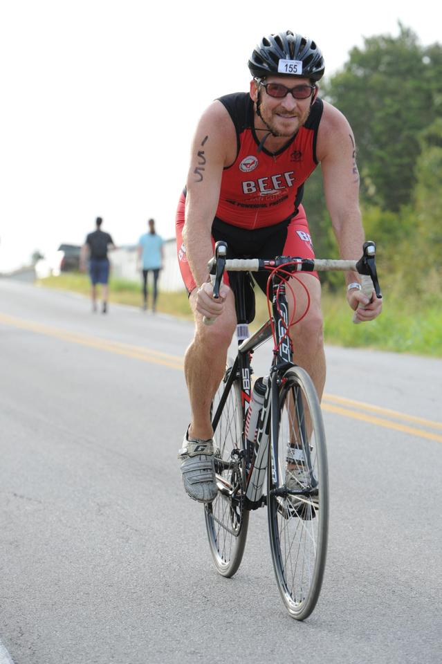 Dylan Cornelius bicycling in the 2019 Jack's Generic Triathlon
