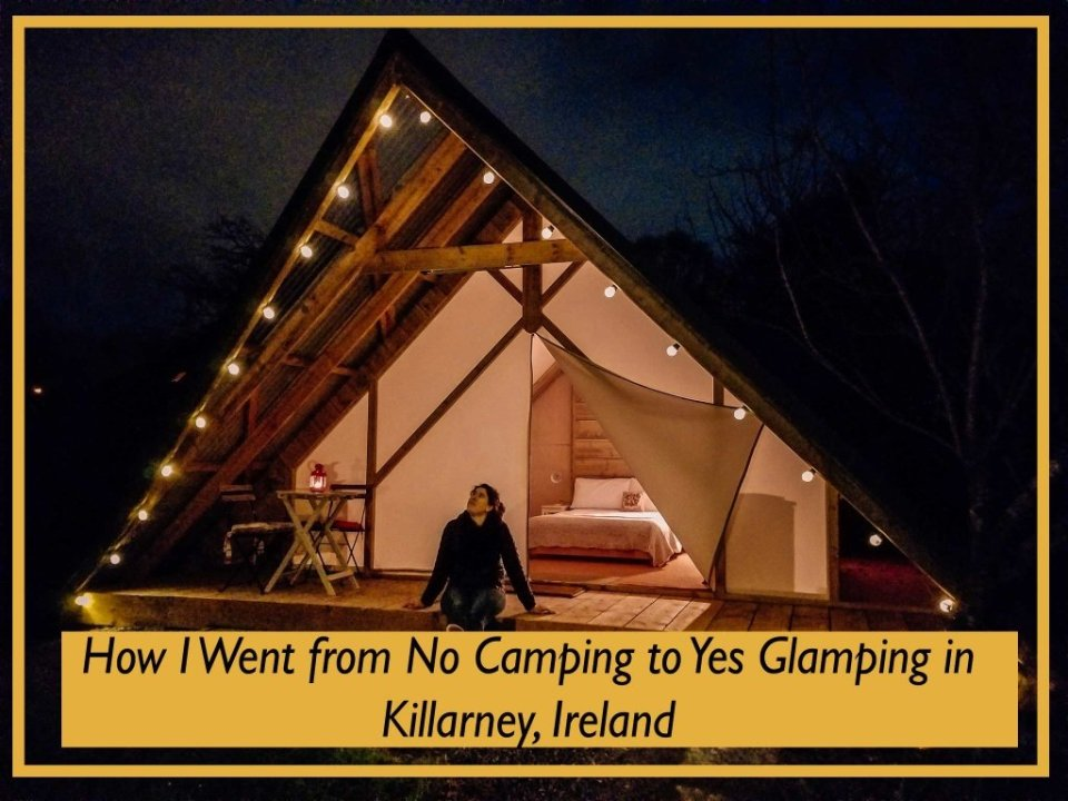 Young woman sitting outside a glamping tent in Killarney Ireland