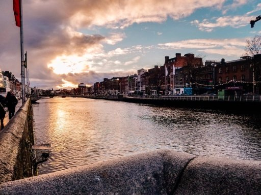The sun setting over the river in downtown Dublin Ireland