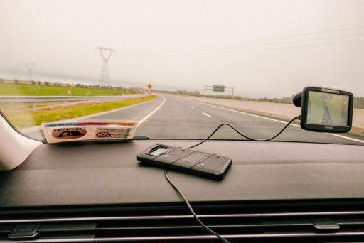 A cell phone holding down the GPS cord during our self drive tour of Ireland
