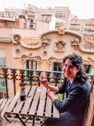 Drinking wine on a balcony in Barcelona Spain