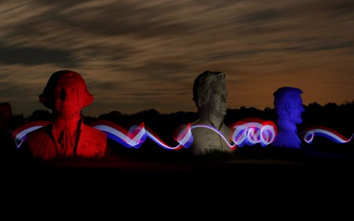 Washington, Jefferson, and Lincoln president heads illuminated in red, white, and blue in Williamsburg, VA