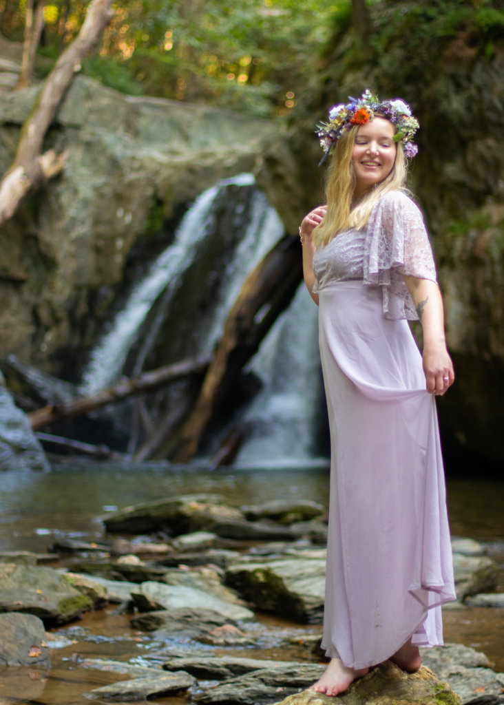 Girl in a purple dress with a flower crown at Kilgore Falls photo shoot