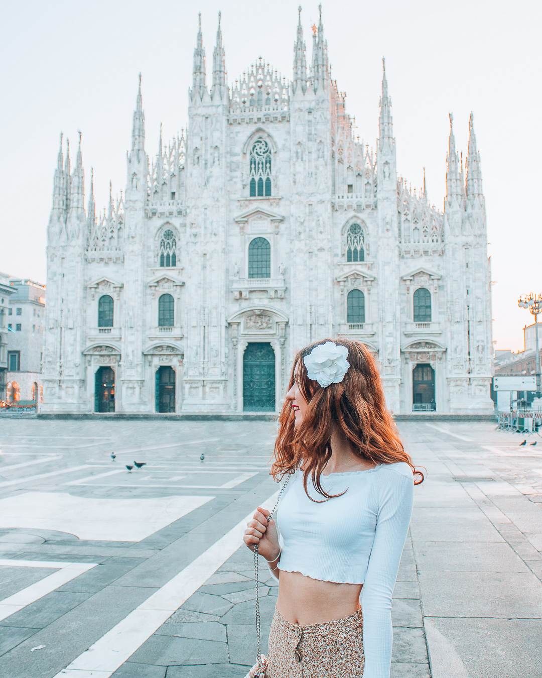 Happy girl in front of the Duomo in Milan