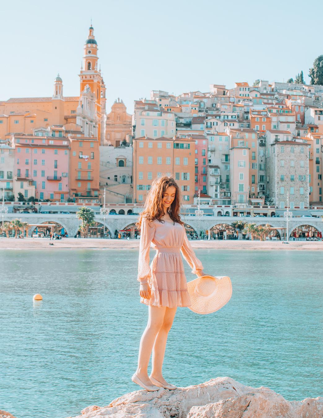 Girl standing on the rocks in Menton