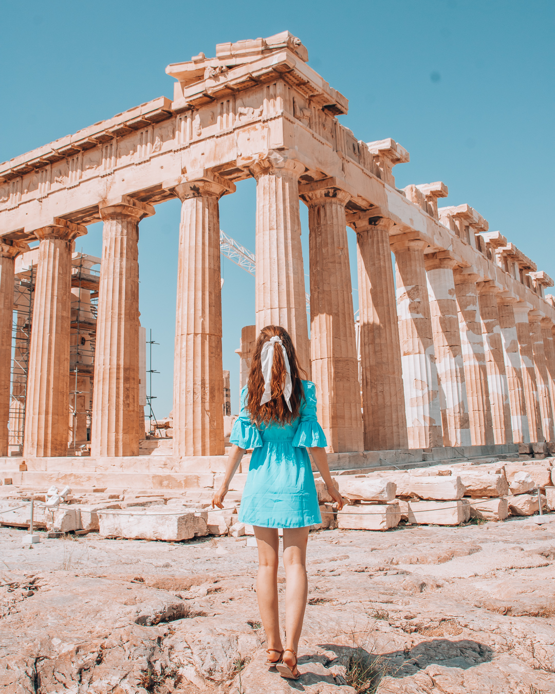 Girl in blue dress in front of the Acropolis