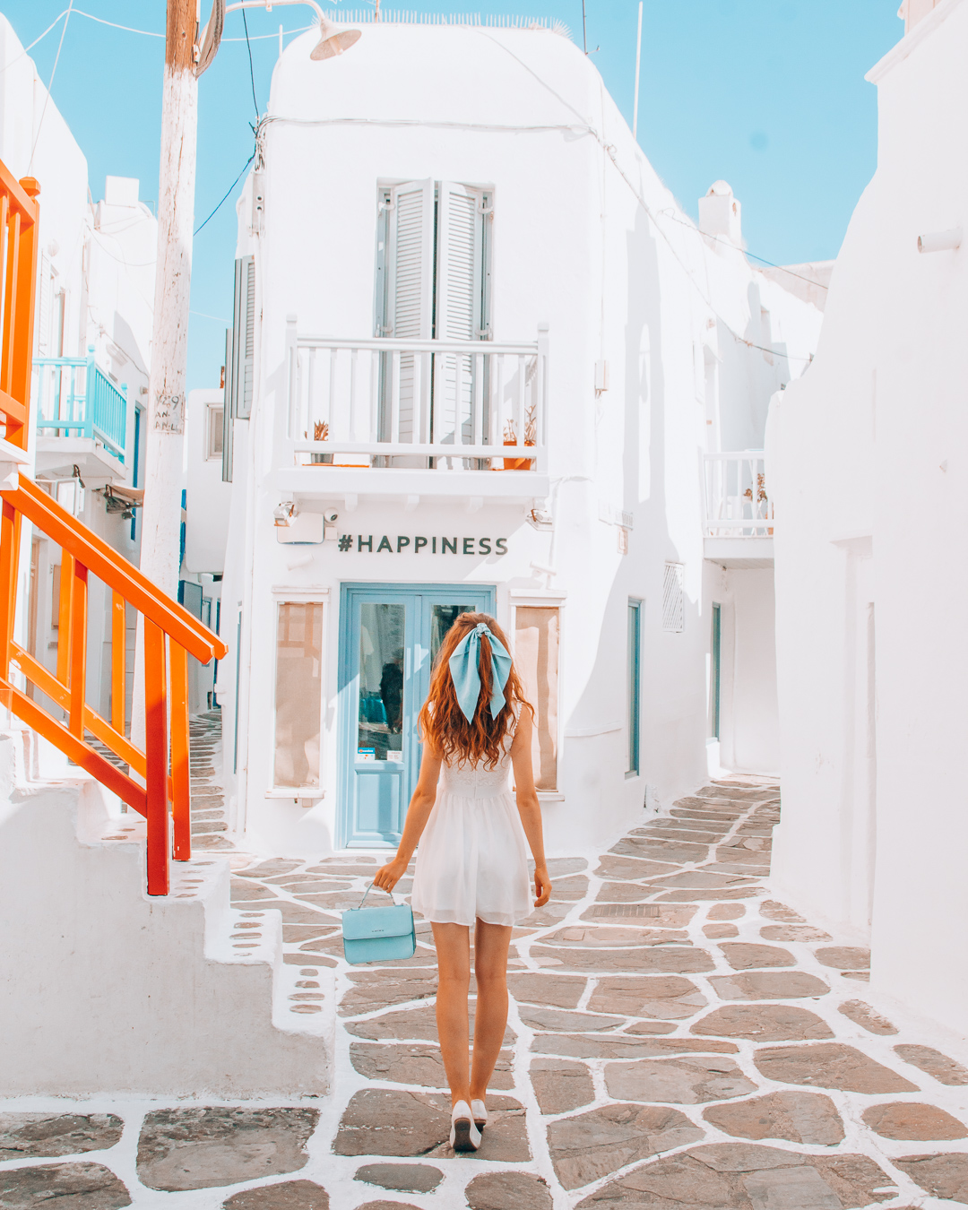 Girl standing in front of a store in Mykonos