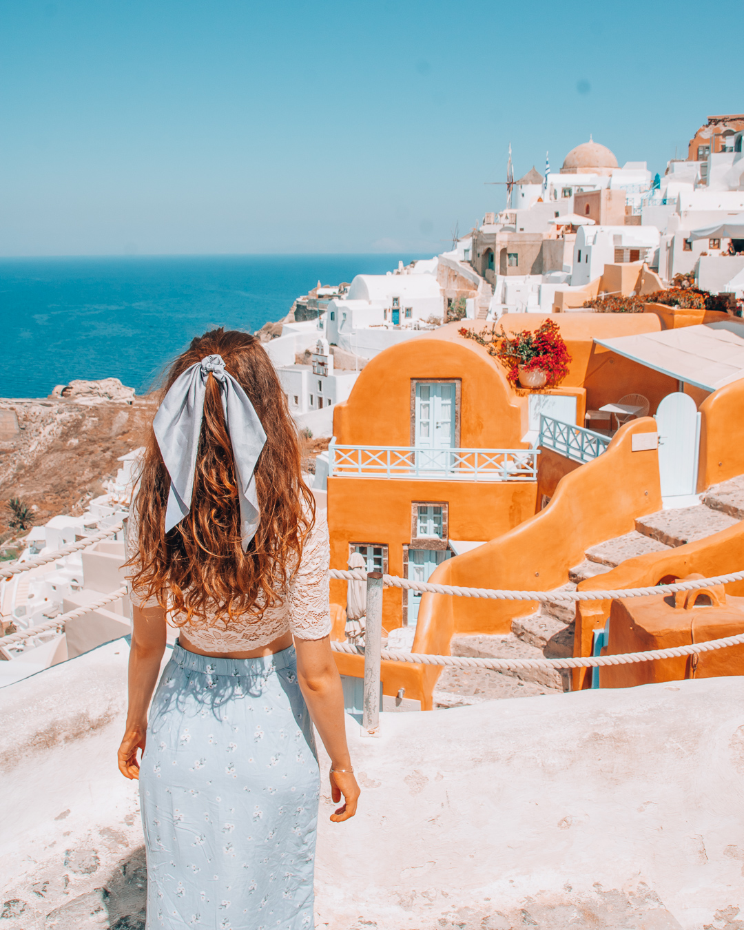 Girl looking at Kastro Oia Houses from above
