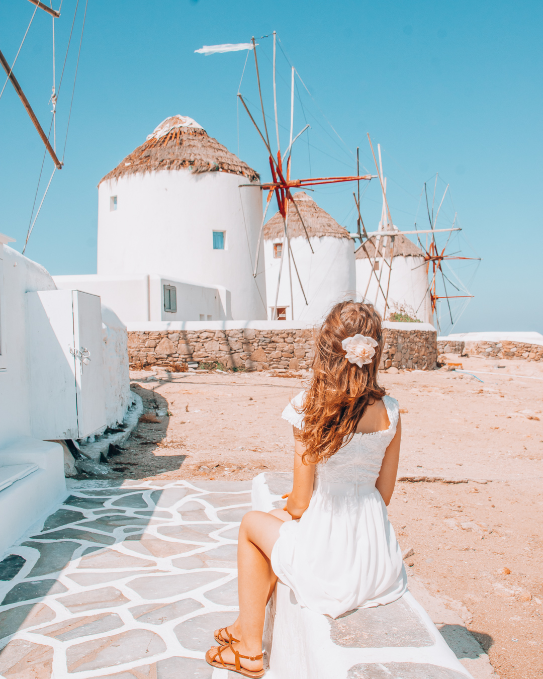 Girl looking at the windmills in Mykonos