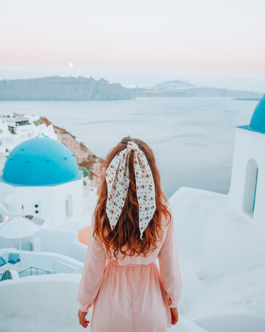 Girl in front of Anastasia Church in Santorini