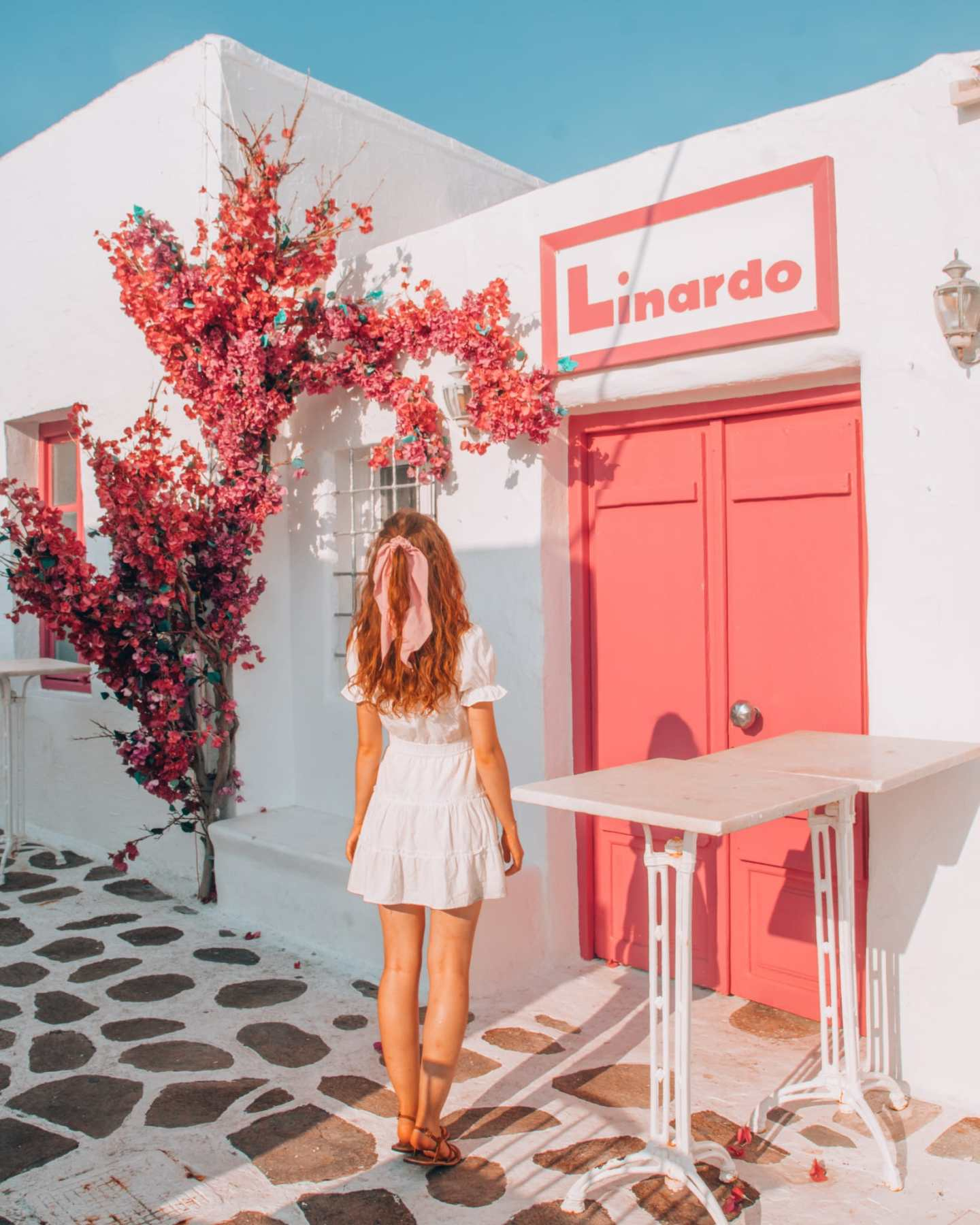 Girl in front of a pink building in Paros