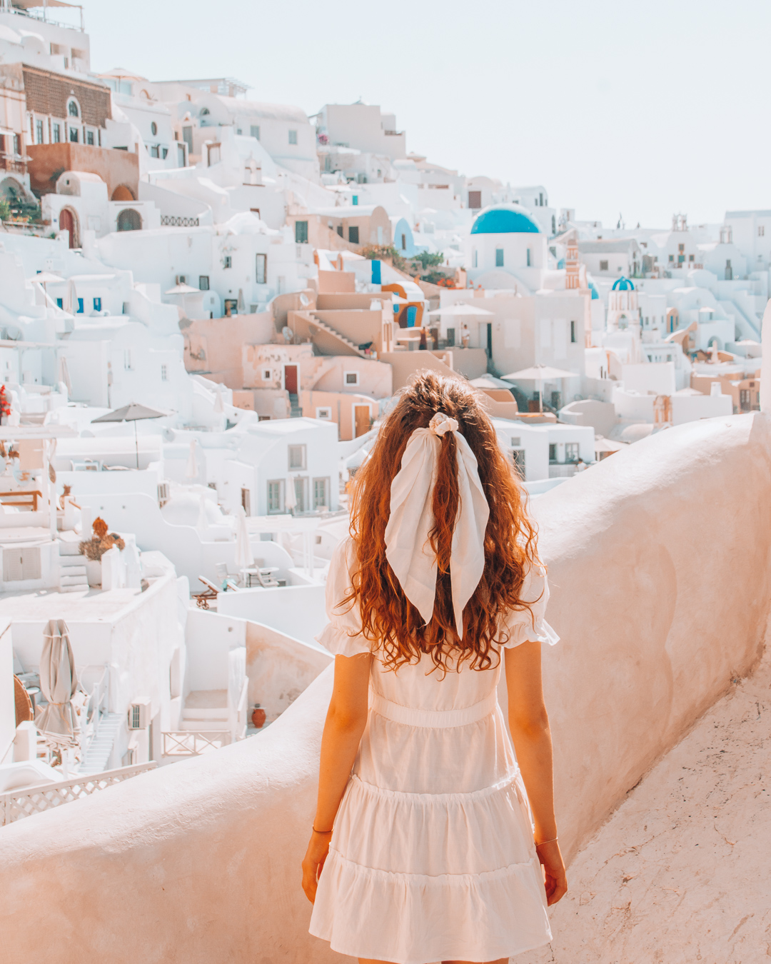 Girl looking at the houses in Oia