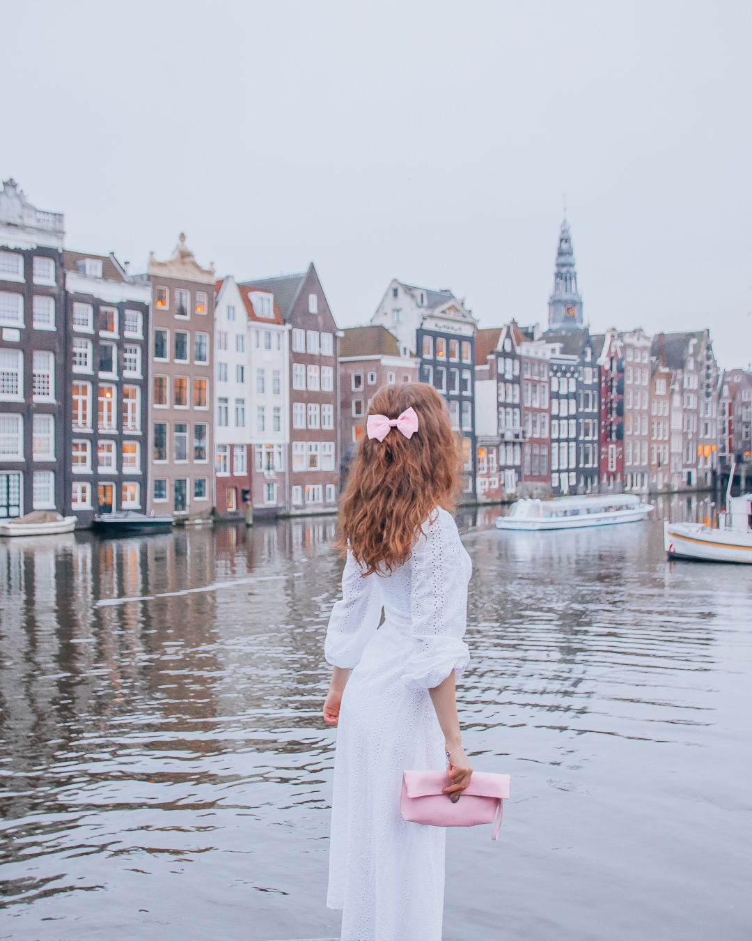 Water, houses and a girl in Amsterdam