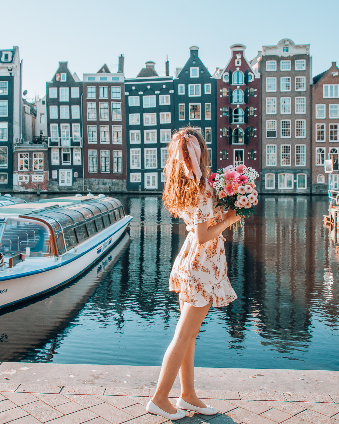 Girl looking at houses in Amsterdam