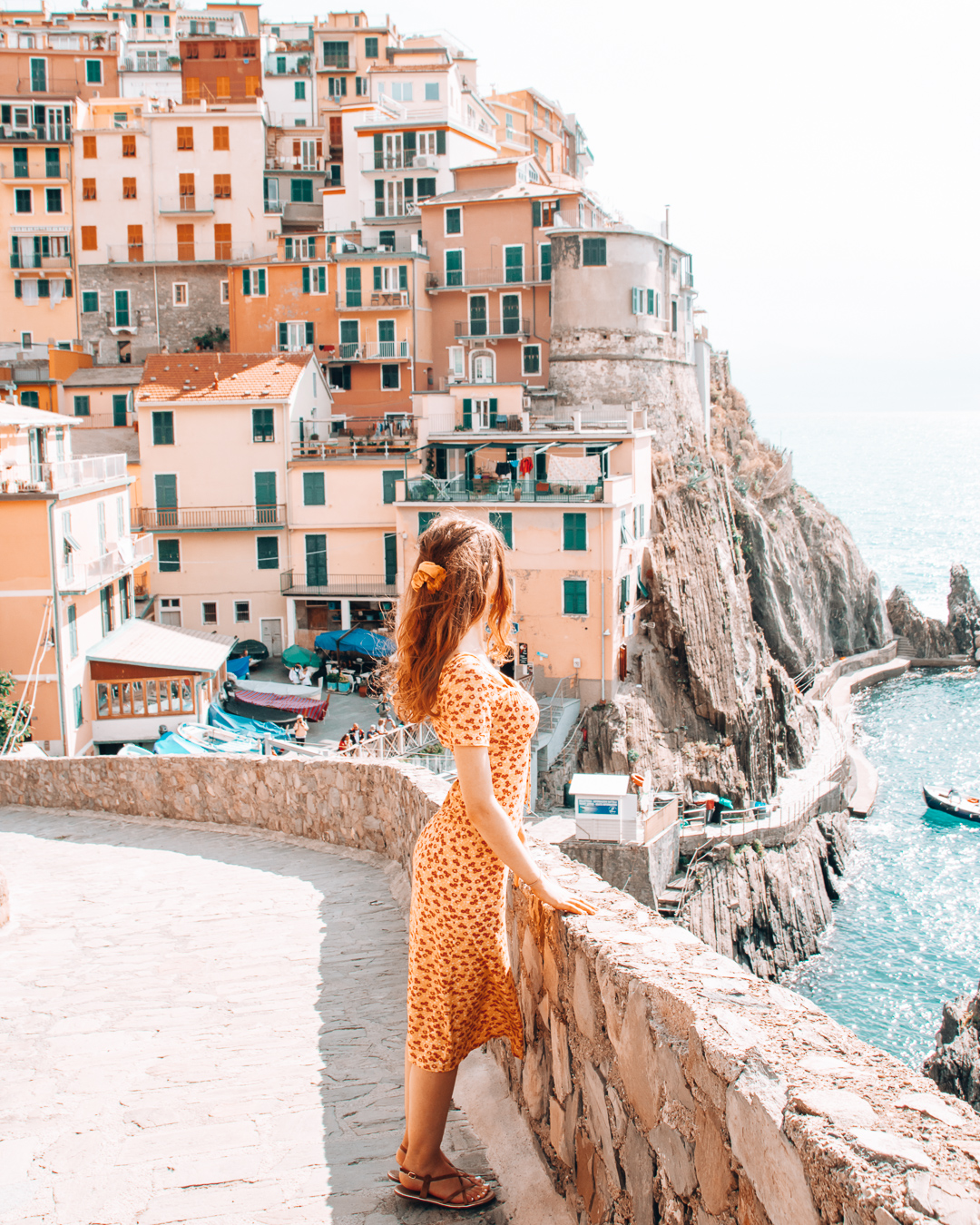 Girl looking at view in Manarola