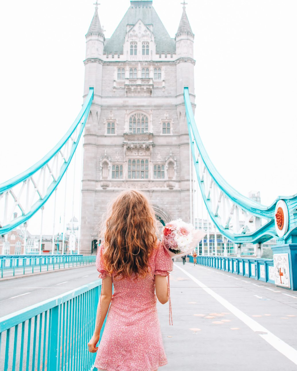Girl in front of the Tower Bridge in London