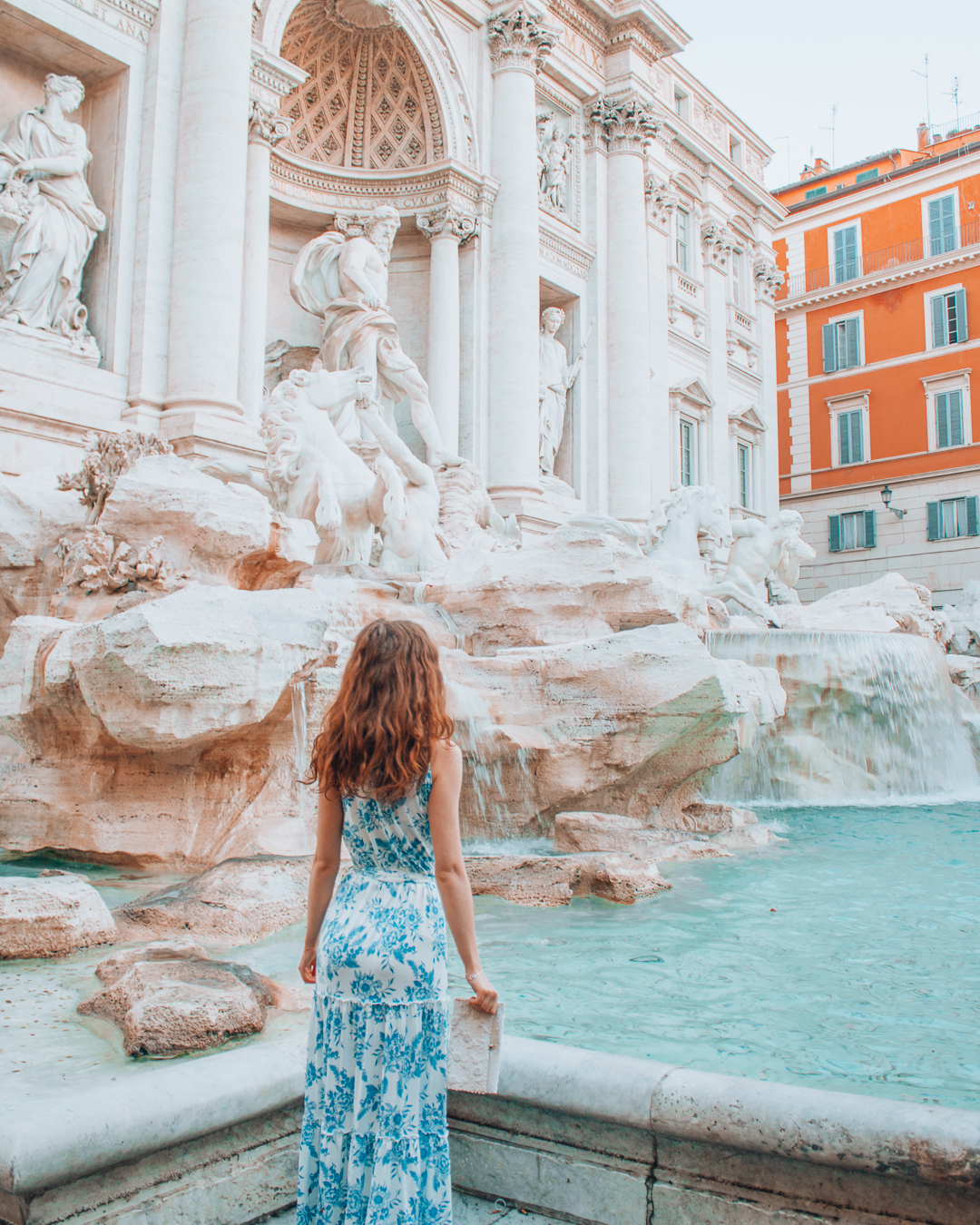 Girl in front of the Trevi Fountain in Rome