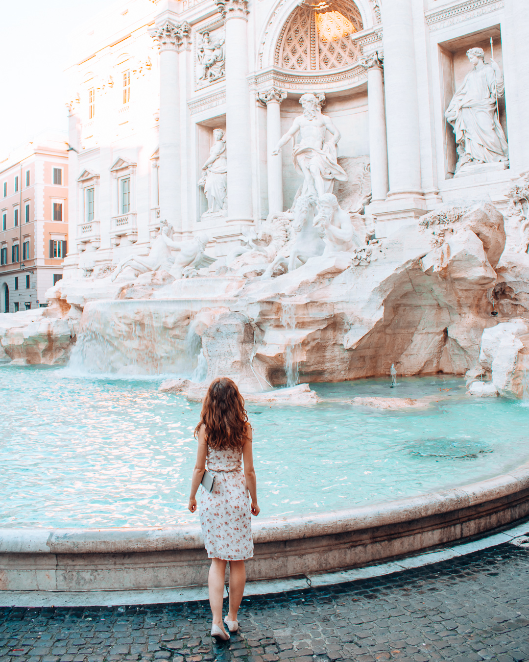 Girl walking towards the Trevi Fountain in Rome