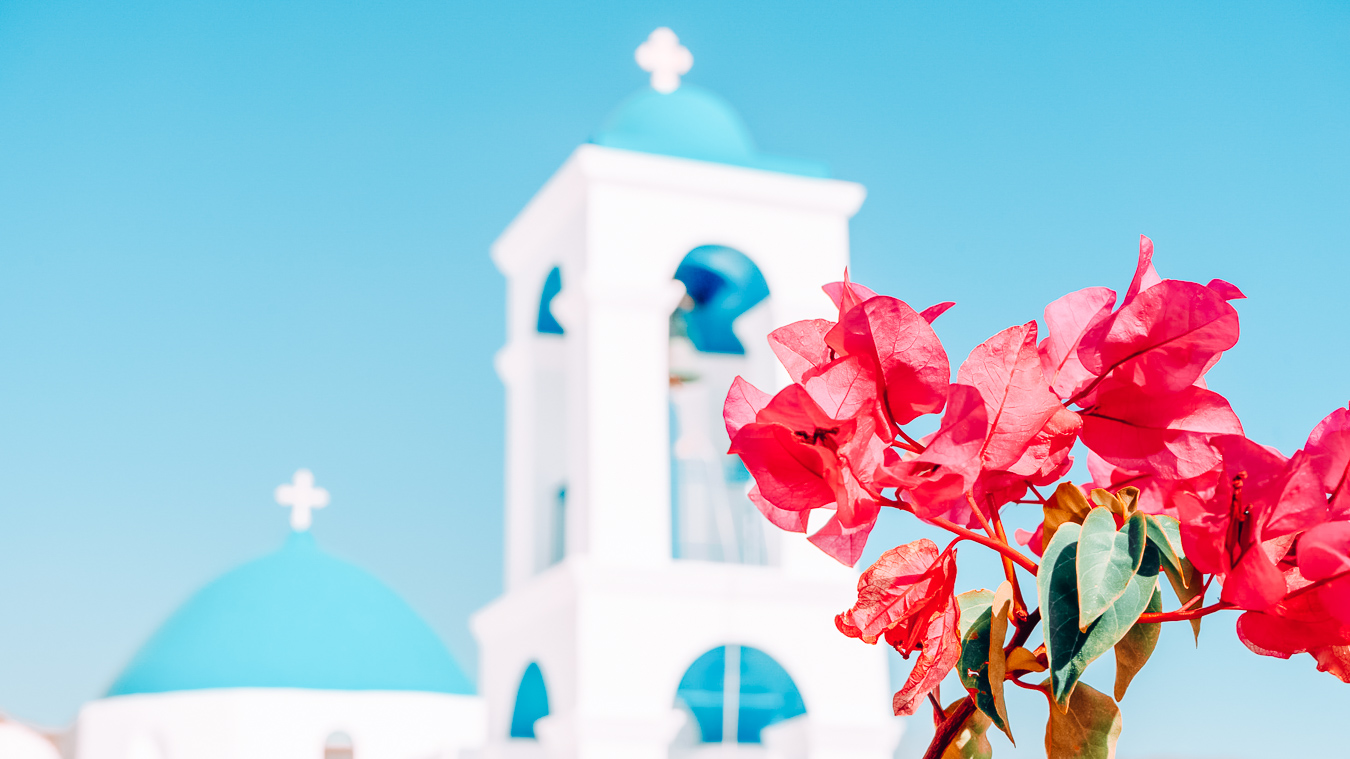 Flowers and chapel in Ios in Greece