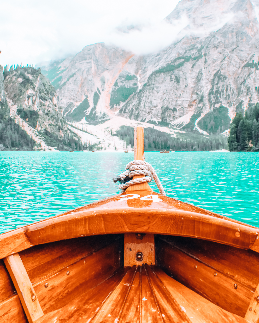 A beautiful view of a lake in the Dolomites from a boat