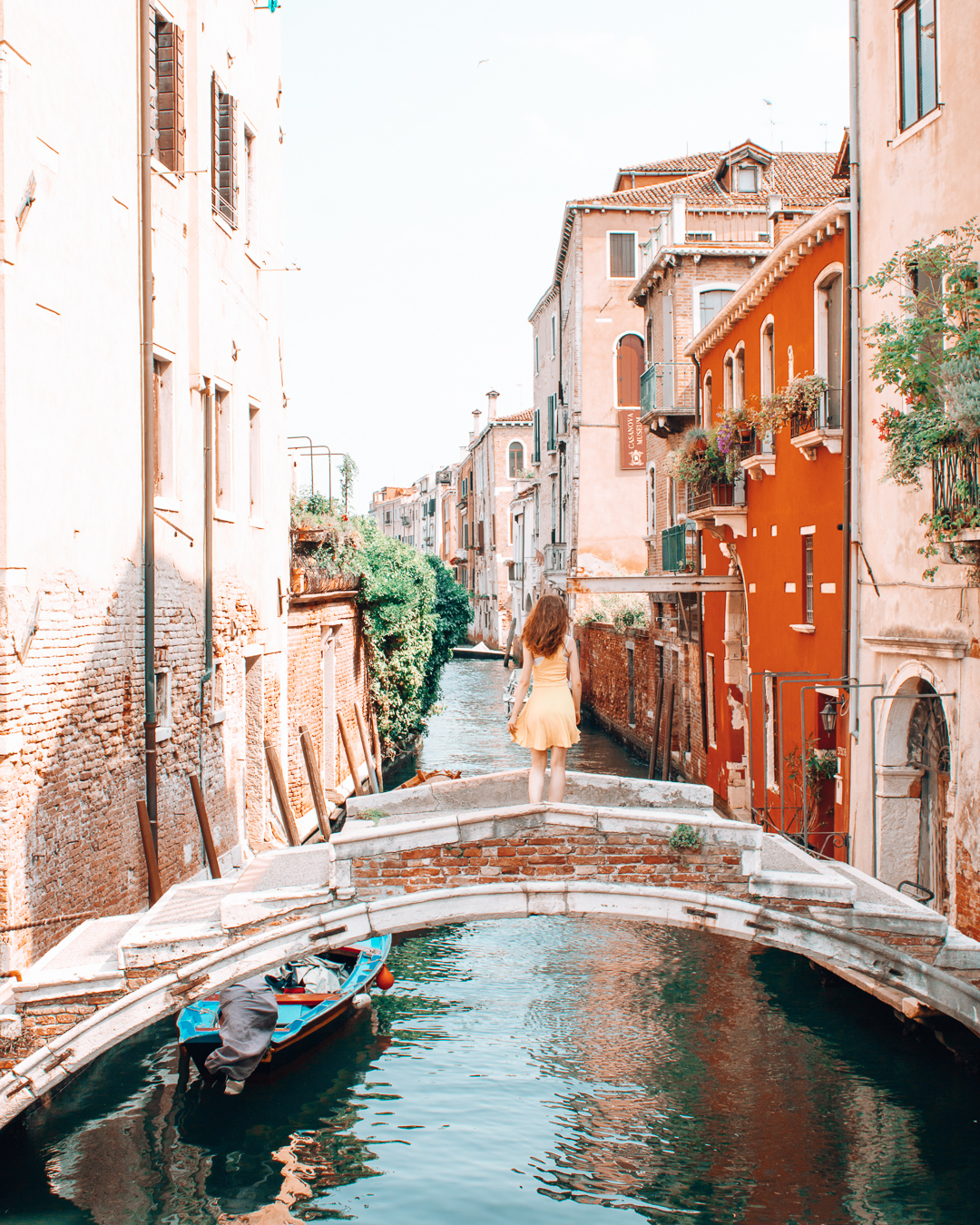 Girl looking at a canal in Venice