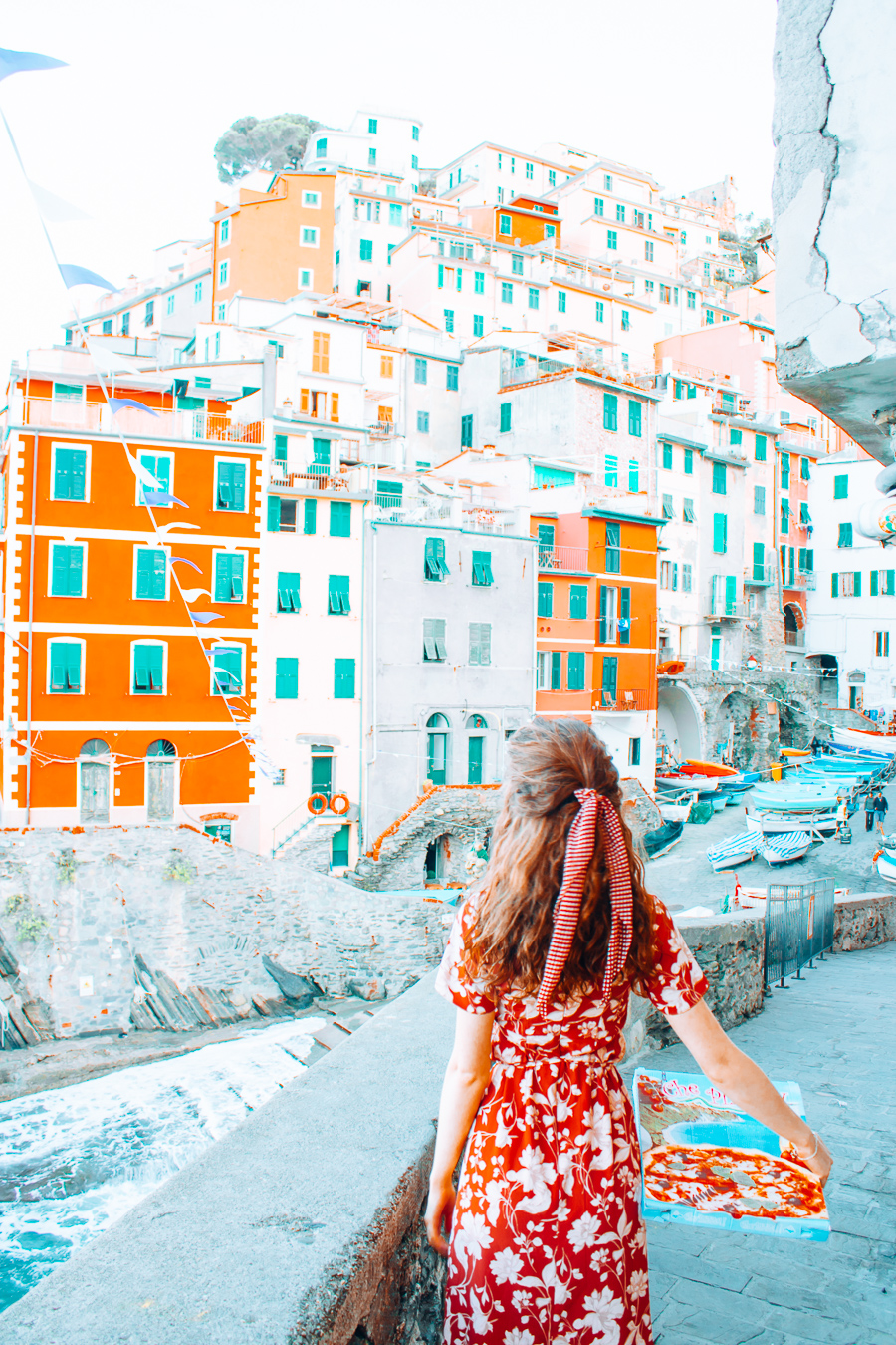 Girl with pizza in Riomaggiore
