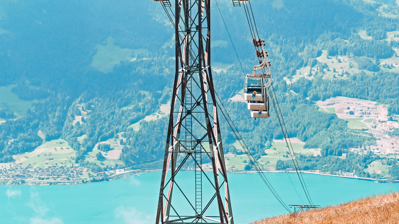 A cable car and a view of the beautiful Lake Thun in Switzerland