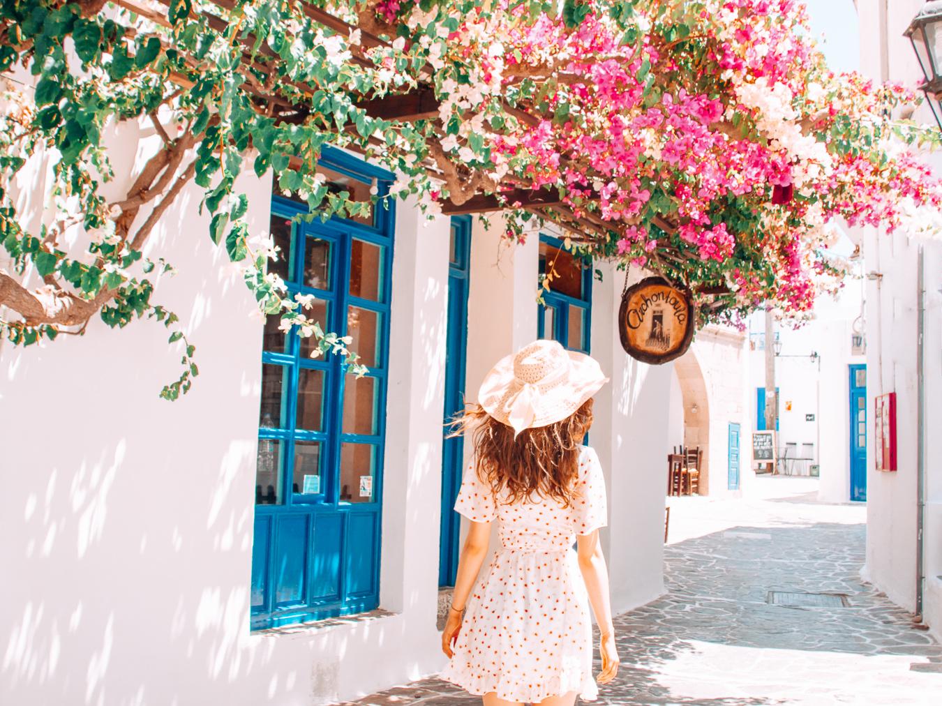 Street with flowers in Milos, Greece