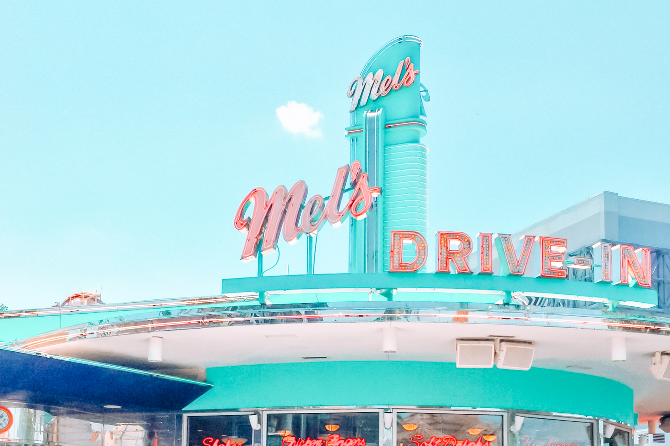 Instagrammable blue restaurant in Orlando with colorful text