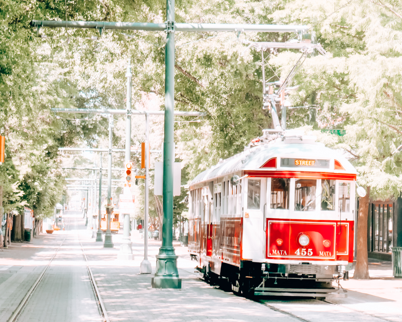 Red trolley and trees