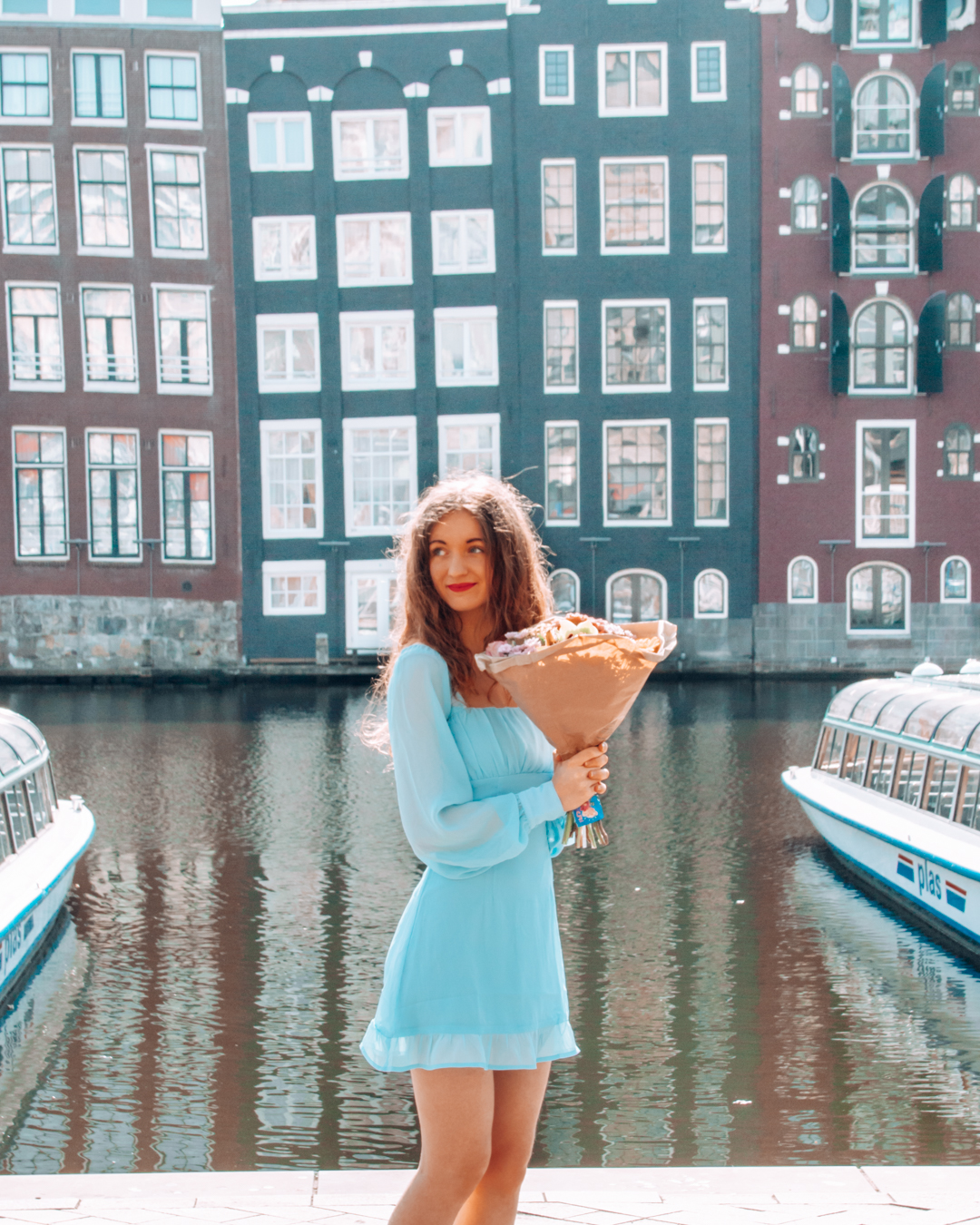 Girl with flowers in Amsterdam