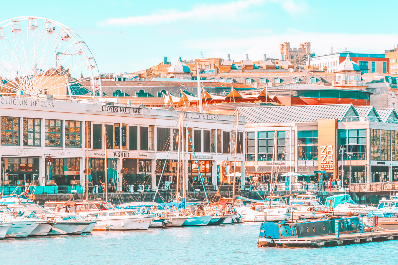 Buildings, boats, and a Ferris wheel