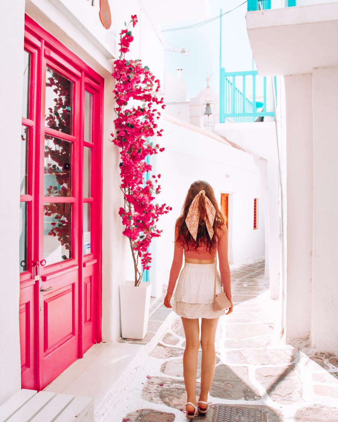 Pink door, flowers, and a street in Mykonos