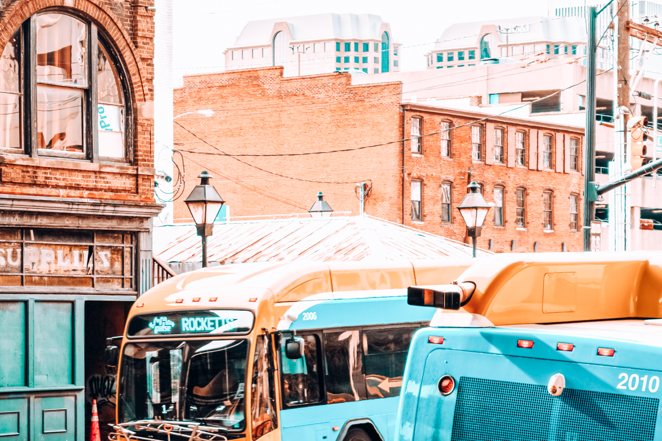 Blue buses and buildings