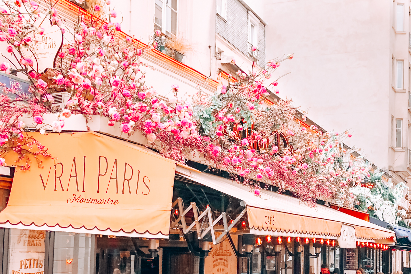 Cafe with cute pink flowers in Paris