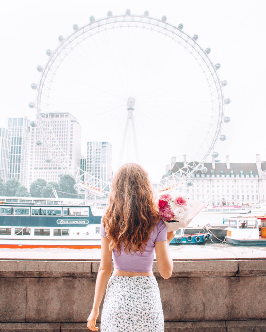 Girl in front of the London Eye