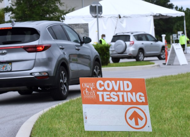 Car A car temporarily enters the Covid-19 test site in East Orange District Park in Orlando, Florida on October 1.