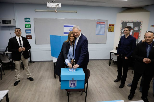 Blue and White party leader Benny Gantz and his wife Revital vote in Rosh Haayin, Israel.