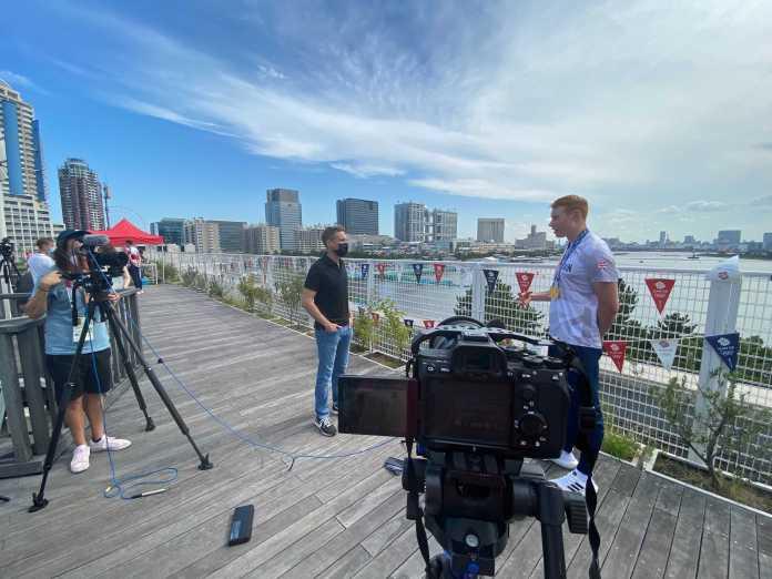CNN interviews Team GB swimmer Tom Dean.  Interviews are held for less than ten minutes.